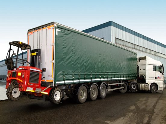 Tractor unit with trailer and Moffett fork lift - hire them all from Maun Motors Self Drive